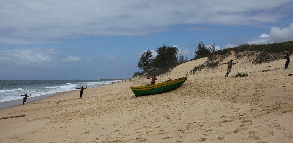 Fishermen hauling their net at the beach just above Maputo.